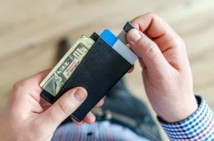 Money and cards are in a small wallet