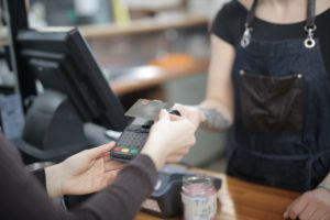 Paying by card at the cash register