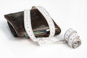 A measure is wrapped around the wallet