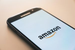 Amazon is written on the screen of the smartphone
