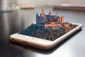 Castle is floating on the screen of the smartphone