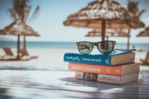 Sunglasses and books on the beach