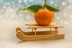 A mandarin orange is on a small ship