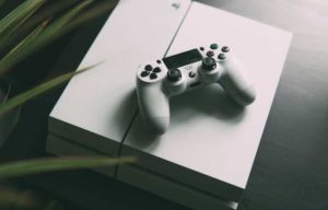 There is a white PS4 and controller
