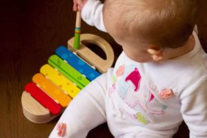Baby playing with xylophone toys