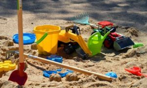 There are many toys in the sandbox